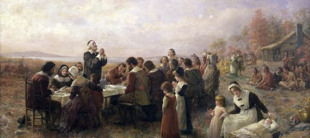 Painting of pilgrims and native Americans celebrating the first Thanksgiving feast